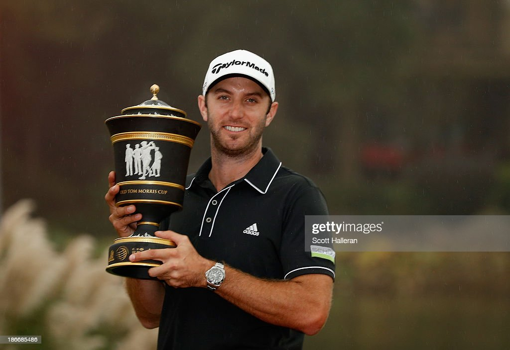 Dustin Johnson of the USA poses with the trophy after his three-stroke victory at the WGC-HSBC Champions at the Sheshan International Golf Club on November 3, 2013 in Shanghai, China.