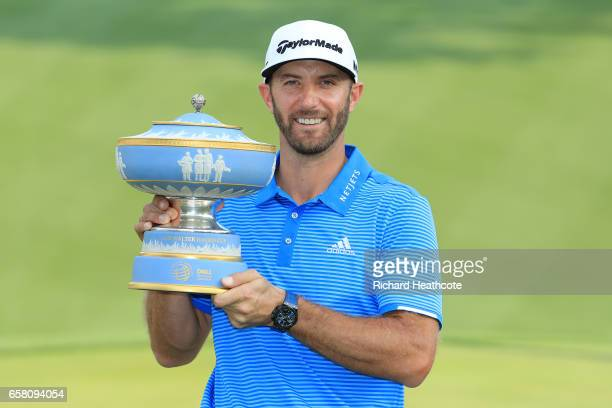 Dustin Johnson of the USA poses with the trophy after winning the World Golf ChampionshipsDell Technologies Match Play at the Austin Country Club on...