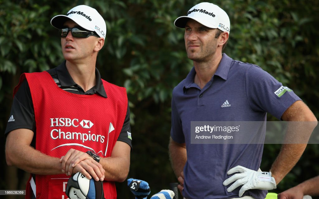 Dustin Johnson of the USA stands with his brother and caddie Austin during the second round of the WGC - HSBC Champions at the Sheshan International Golf Club on November 1, 2013 in Shanghai, China.