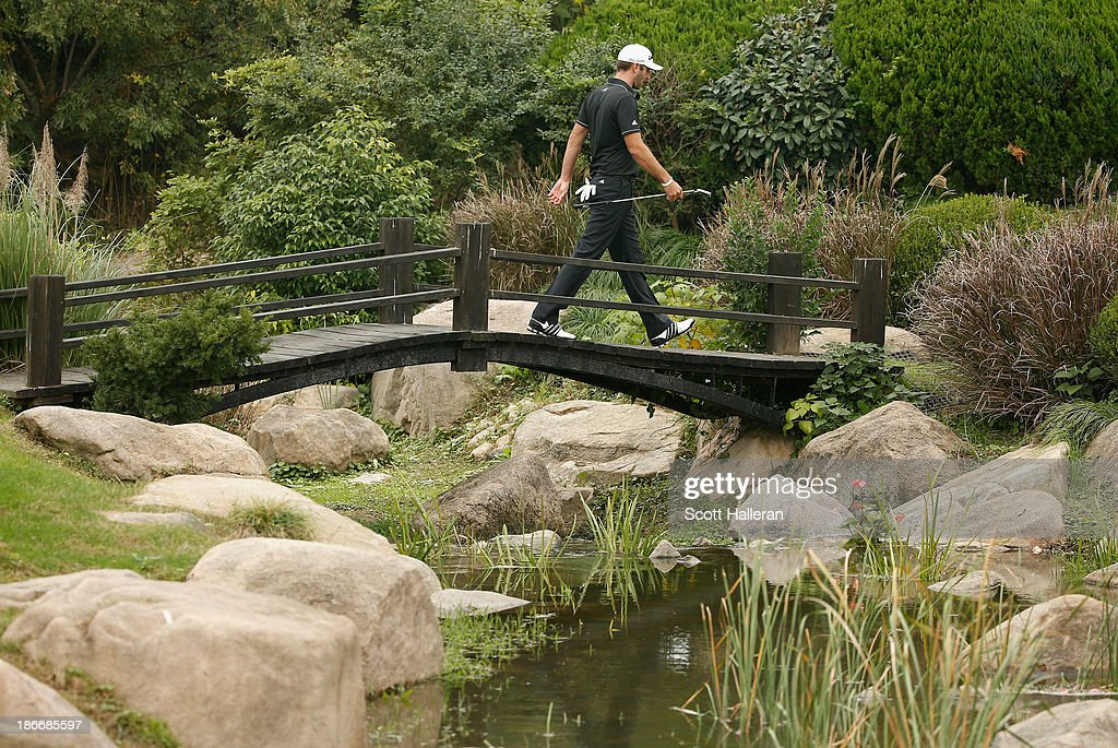 <a gi-track='captionPersonalityLinkClicked' href=/galleries/search?phrase=Dustin+Johnson&family=editorial&specificpeople=3908453 ng-click='$event.stopPropagation()'>Dustin Johnson</a> of the USA walks to the eighth green during the final round of the WGC-HSBC Champions at the Sheshan International Golf Club on November 3, 2013 in Shanghai, China.