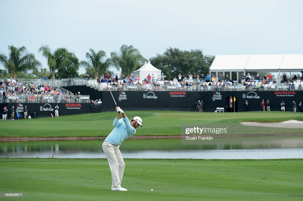 Dustin Johnson of USA plays his approach shot on the 16th hole during the first round of the Honda Classic on February 28, 2013 in Palm Beach Gardens, Florida.