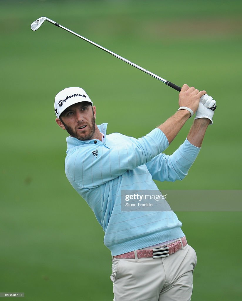 Dustin Johnson of USA plays his approach shot on the eighth hole during the first round of the Honda Classic on February 28, 2013 in Palm Beach Gardens, Florida.