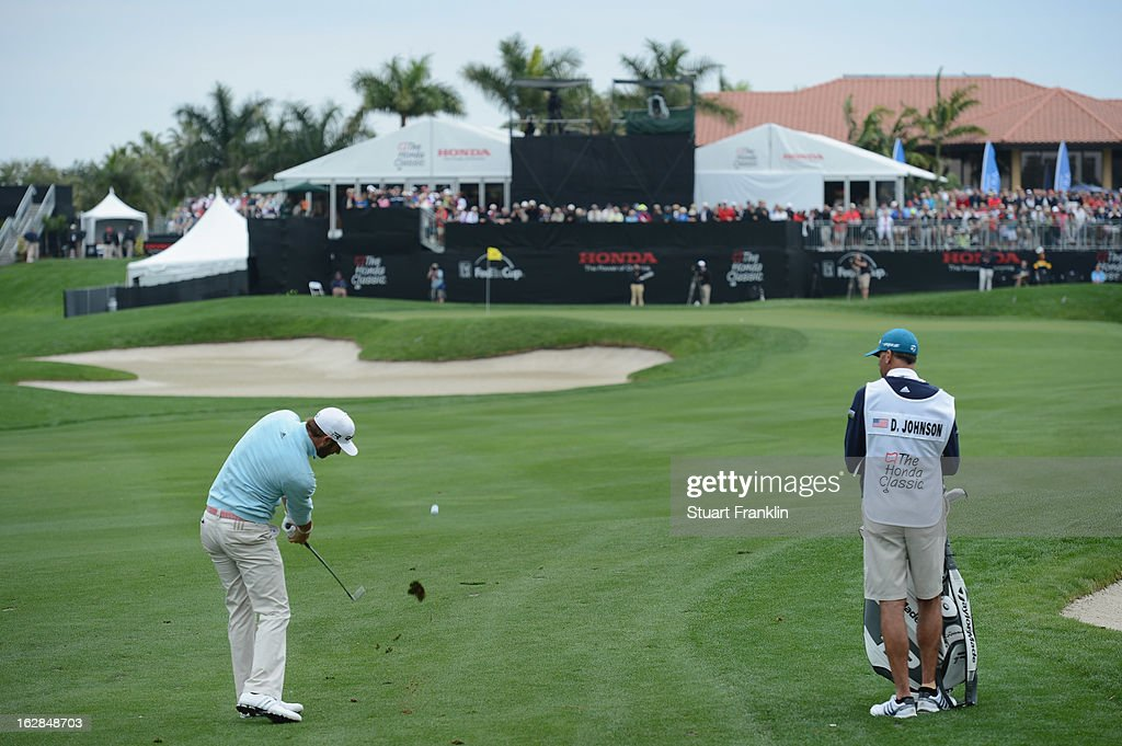 Dustin Johnson of USA plays his approach shot on the nineth hole during the first round of the Honda Classic on February 28, 2013 in Palm Beach Gardens, Florida.