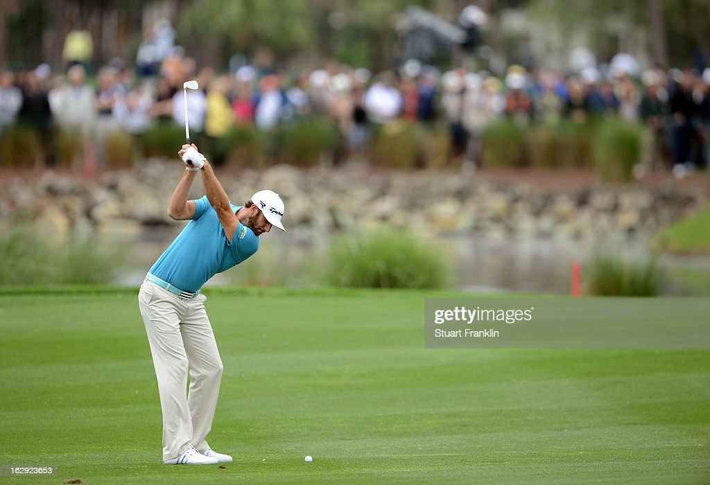 Dustin Johnson of USA plays his approach shot on the sixth hole during the second round of the Honda Classic on March 1, 2013 in Palm Beach Gardens, Florida.