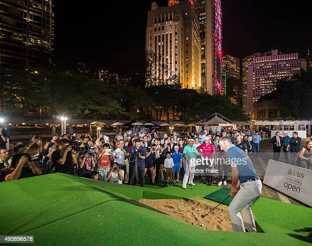 Dustin Johnson of USA splashes out of a bunker as Victor Dubuisson of France Graeme Mcdowell of Northern Ireland Patrick Reed Dustin Johnson of USA...