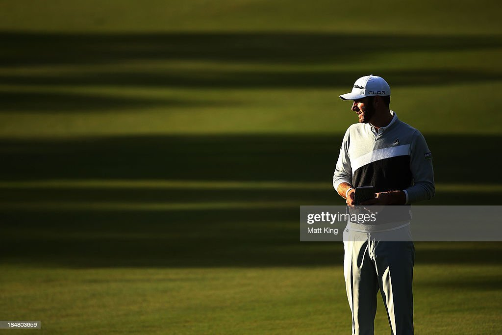 <a gi-track='captionPersonalityLinkClicked' href=/galleries/search?phrase=Dustin+Johnson&family=editorial&specificpeople=3908453 ng-click='$event.stopPropagation()'>Dustin Johnson</a> of USA waits for play during day one of the Perth International at Lake Karrinyup Country Club on October 17, 2013 in Perth, Australia.