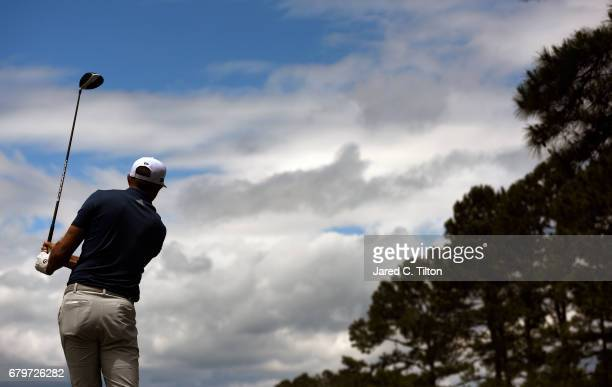 Dustin Johnson plays his shot from the 12th tee during round three of the Wells Fargo Championship at Eagle Point Golf Club on May 6 2017 in...
