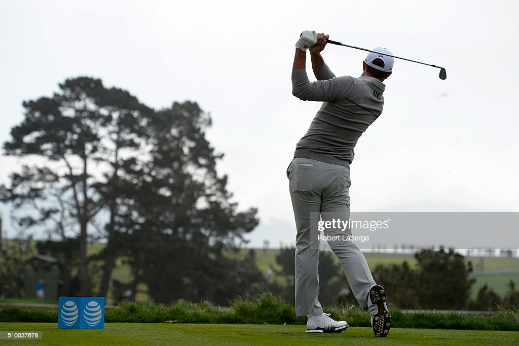 <a gi-track='captionPersonalityLinkClicked' href=/galleries/search?phrase=Dustin+Johnson&family=editorial&specificpeople=3908453 ng-click='$event.stopPropagation()'>Dustin Johnson</a> plays his tee shot on the fifth hole during round three of the AT&T Pebble Beach National Pro-Am at the Pebble Beach Golf Links on February 13, 2016 in Pebble Beach, California.