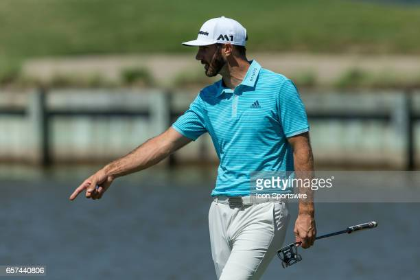 Dustin Johnson points to Martin Kaymer balls on the thirteenth hole during the second round of the WGCDell Technologies Match Play on March 23 at...