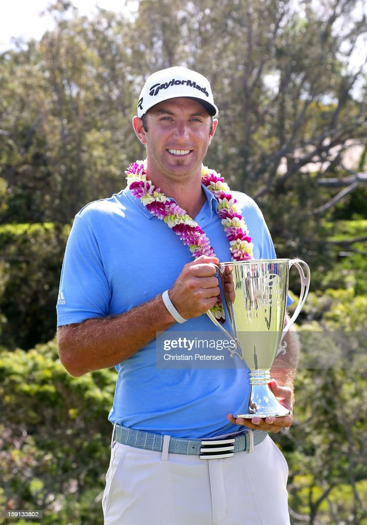 Dustin Johnson poses with the Hyundai Tournament of Champions Cup after winning in the final round at the Plantation Course on January 8, 2013 in Kapalua, Hawaii.