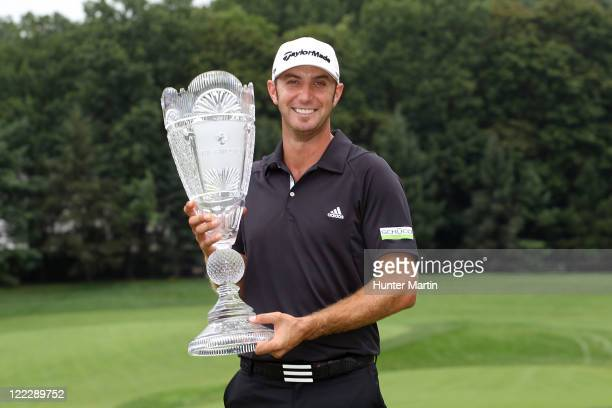 Dustin Johnson poses with the trophy after he finished at 19 to win the tournament following the third and final round of The Barclays at Plainfield...