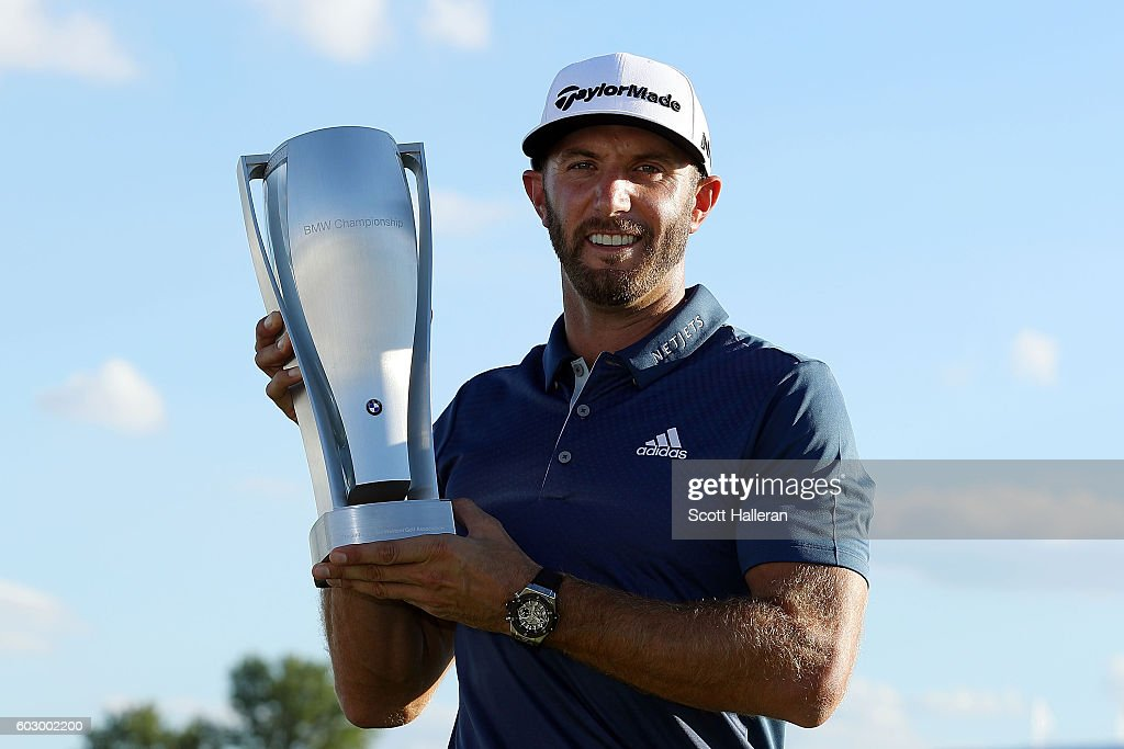 Dustin Johnson poses with the trophy after his three stroke victory at the BMW Championship at Crooked Stick Golf Club on September 11, 2016 in Carmel, Indiana.