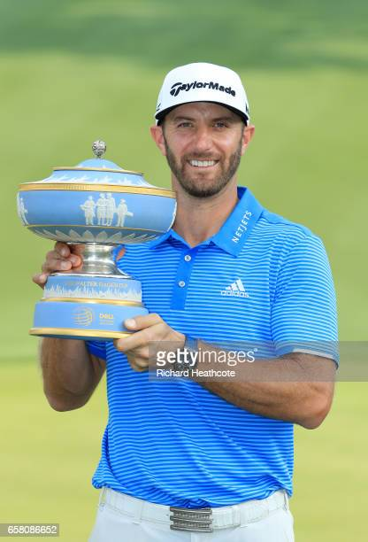 Dustin Johnson poses with the trophy after winning the World Golf ChampionshipsDell Technologies Match Play at the Austin Country Club on March 26...