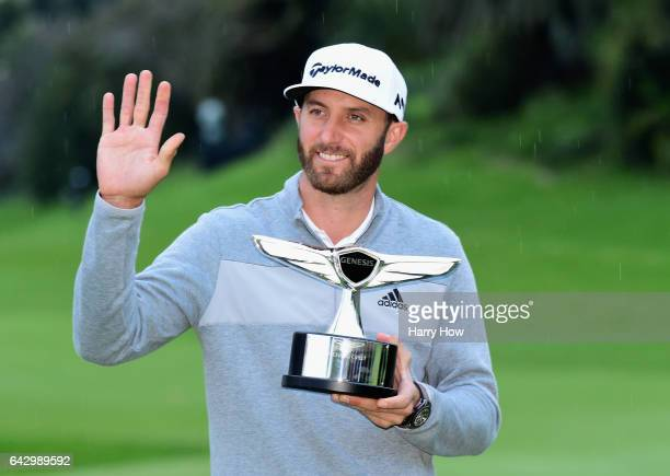 Dustin Johnson poses with the trophy during the final round at the Genesis Open at Riviera Country Club on February 19 2017 in Pacific Palisades...