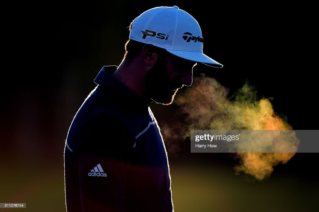 Dustin Johnson practices on the driving range before the start of his play during round two of the Northern Trust Open at Riviera Country Club on...