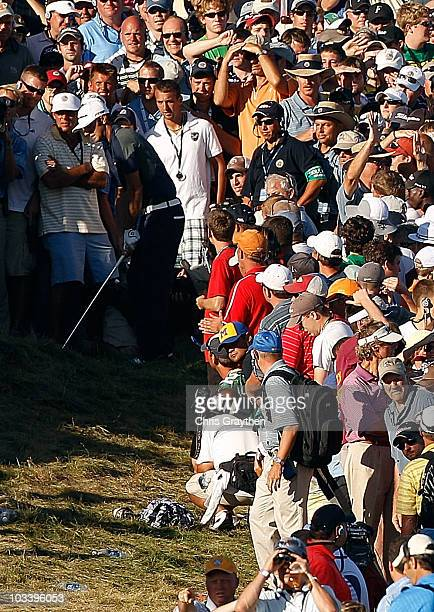 Dustin Johnson prepares to play his second shot on the 18th hole during the final round of the 92nd PGA Championship on the Straits Course at...