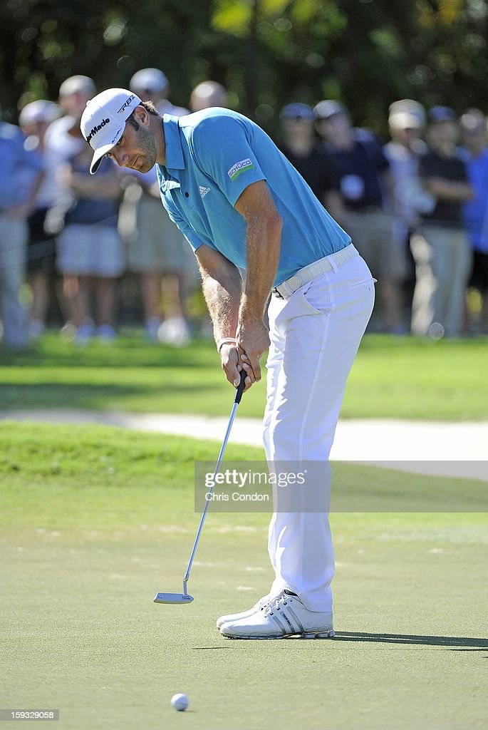 Dustin Johnson putts for birdie on the ninth hole during the second round of the Sony Open in Hawaii at Waialae Country Club on January 11, 2013 in Honolulu, Hawaii.