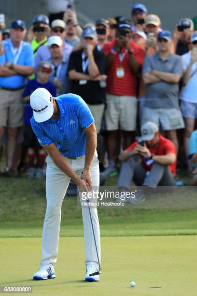 Dustin Johnson putts for par to win the final match of the World Golf ChampionshipsDell Technologies Match Play over Jon Rahm of Spain 1 up on the...
