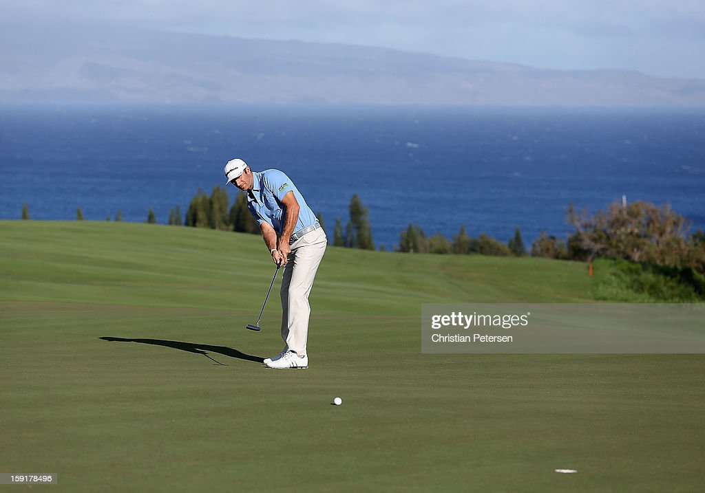 Dustin Johnson putts on 12th hole green during the final round of the Hyundai Tournament of Champions at the Plantation Course on January 8, 2013 in Kapalua, Hawaii.