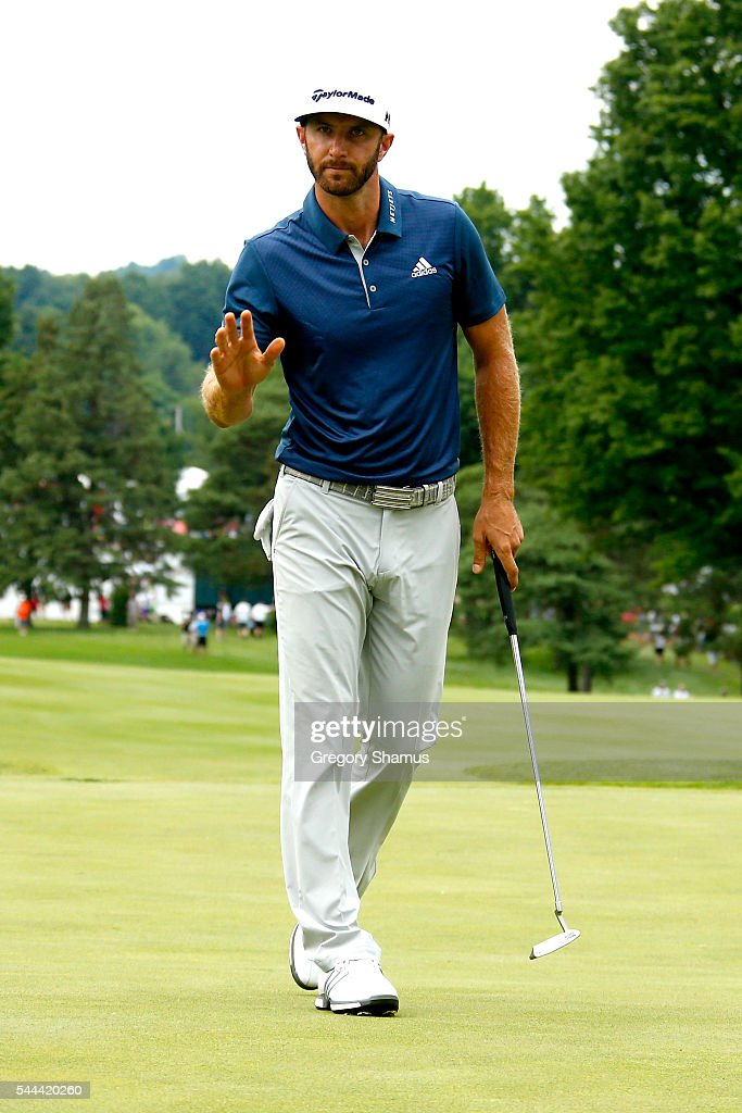 Dustin Johnson reacts after a birdie on the 17th green during the final round of the World Golf Championships - Bridgestone Invitational at Firestone Country Club South Course on July 3, 2016 in Akron, Ohio.