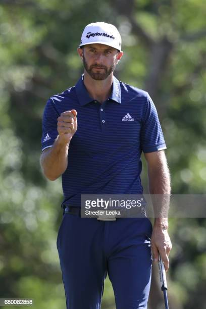 Dustin Johnson reacts after putting on the 18th green during the final round of the Wells Fargo Championship at Eagle Point Golf Club on May 7 2017...