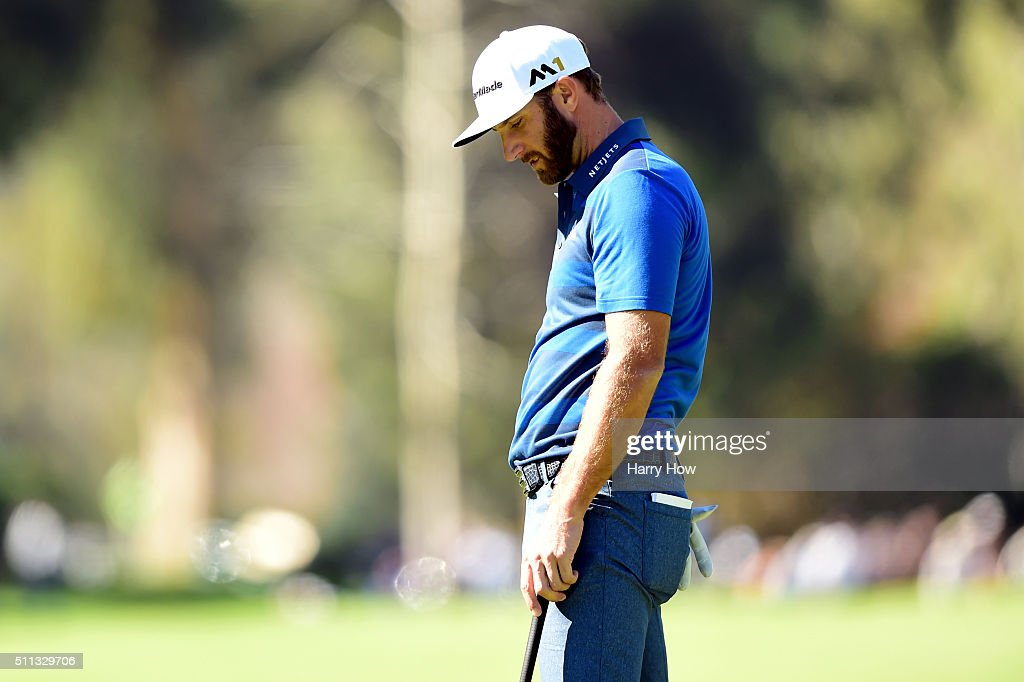 Dustin Johnson reacts to a missed birdie putt on the eighth hole during round two of the Northern Trust Open at Riviera Country Club on February 19...