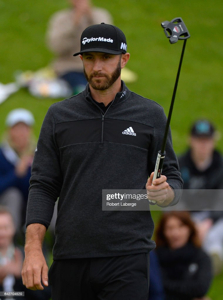Dustin Johnson reacts to his birdie on the 18th hole during a continuation of the second round at the Genesis Open at Riviera Country Club on February 18, 2017 in Pacific Palisades, California.