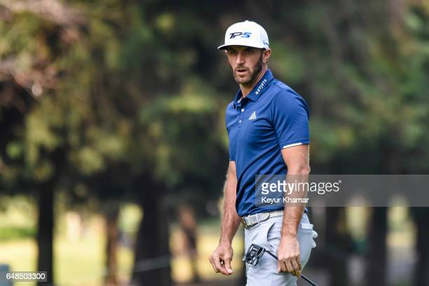 Dustin Johnson reacts to his putt on the 16th hole green during the final round of the World Golf ChampionshipsMexico Championship at Club de Golf...