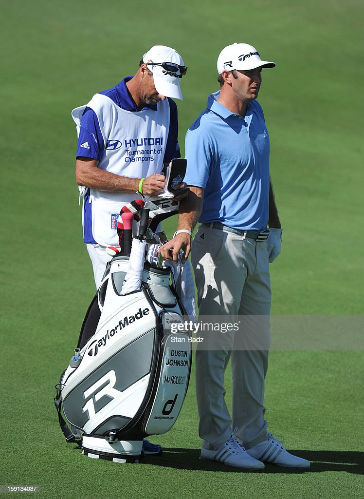 Dustin Johnson selects a club from his bag on the 13th hole during the final round of the Hyundai Tournament of Champions at Plantation Course at Kapalua on January 8, 2013 in Kapalua, Maui, Hawaii.