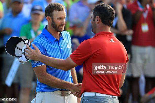 Dustin Johnson shakes hands with Jon Rahm of Spain after winning the final match of the World Golf ChampionshipsDell Technologies Match Play 1 up on...