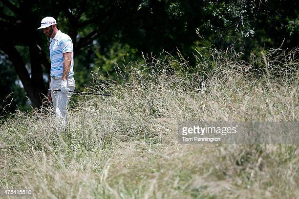 Dustin Johnson stands in the grass on the sixth hole during the Final Round of the ATT Byron Nelson at the TPC Four Seasons Resort Las Colinas on May...