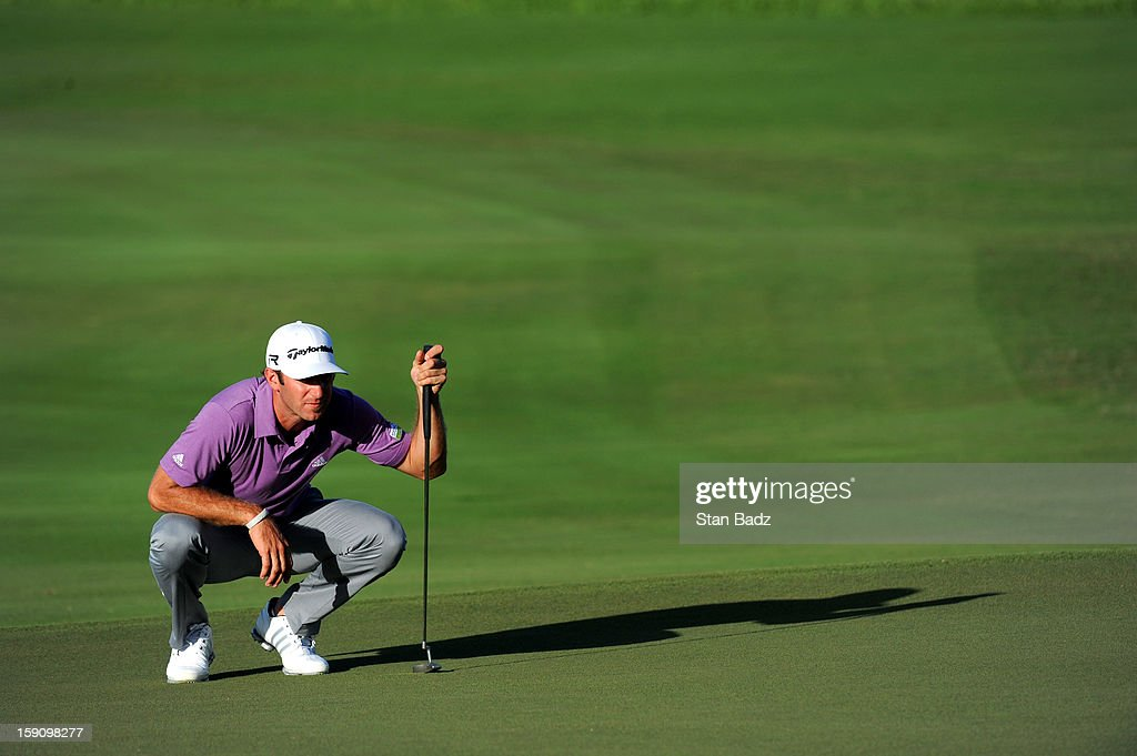 Dustin Johnson studies his putt on the 16th hole during the second round of the Hyundai Tournament of Champions at Plantation Course at Kapalua on January 7, 2013 in Kapalua, Maui, Hawaii.