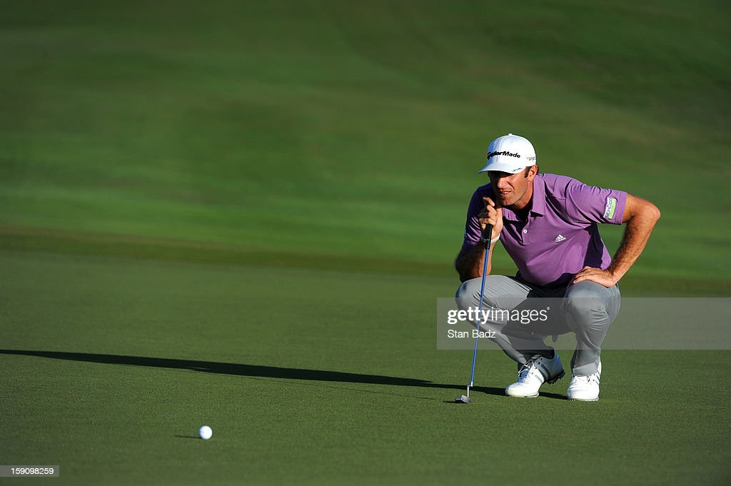 <a gi-track='captionPersonalityLinkClicked' href=/galleries/search?phrase=Dustin+Johnson&family=editorial&specificpeople=3908453 ng-click='$event.stopPropagation()'>Dustin Johnson</a> studies his putt on the 18th green during the second round of the Hyundai Tournament of Champions at Plantation Course at Kapalua on January 7, 2013 in Kapalua, Maui, Hawaii.