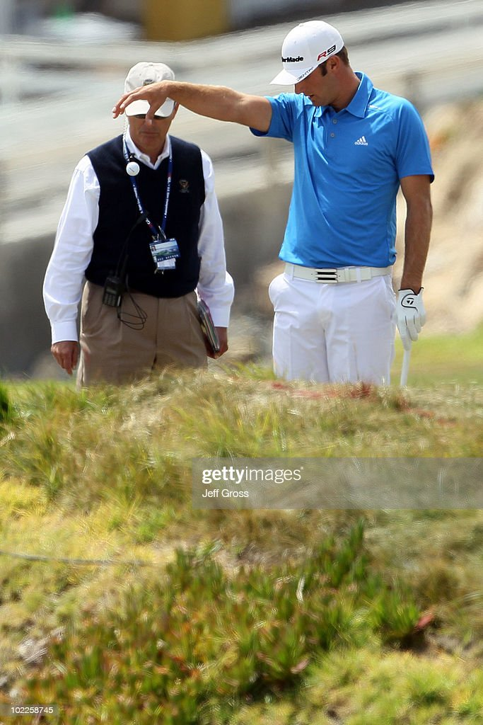 <a gi-track='captionPersonalityLinkClicked' href=/galleries/search?phrase=Dustin+Johnson&family=editorial&specificpeople=3908453 ng-click='$event.stopPropagation()'>Dustin Johnson</a> takes a penalty drop on the fourth hole alongside a USGA rules official during the final round of the 110th U.S. Open at Pebble Beach Golf Links on June 20, 2010 in Pebble Beach, California.