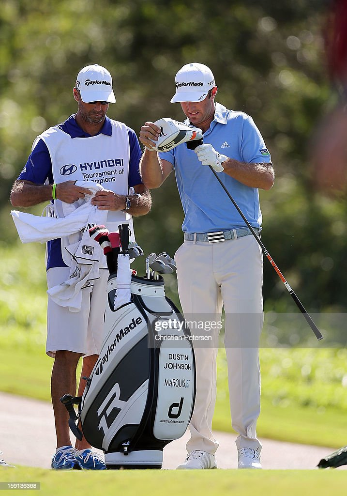 Dustin Johnson takes his driver out of his bag before hitting a tee shot on 18th hole during the final round of the Hyundai Tournament of Champions at the Plantation Course on January 8, 2013 in Kapalua, Hawaii.