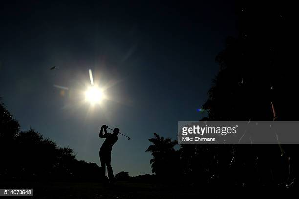 Dustin Johnson tees off on the 13th hole during the final round of the World Golf ChampionshipsCadillac Championship at Trump National Doral Blue...