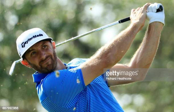 Dustin Johnson tees off on the 7th hole of his match during the semifinals of the World Golf ChampionshipsDell Technologies Match Play at the Austin...