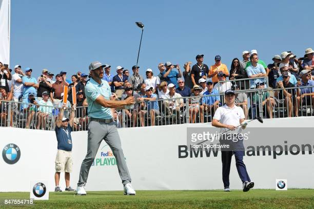 Dustin Johnson tees off on the ninth hole next to Justin Thomas during the First Round of the BMW Championship on September 14 at Conway Farms Golf...