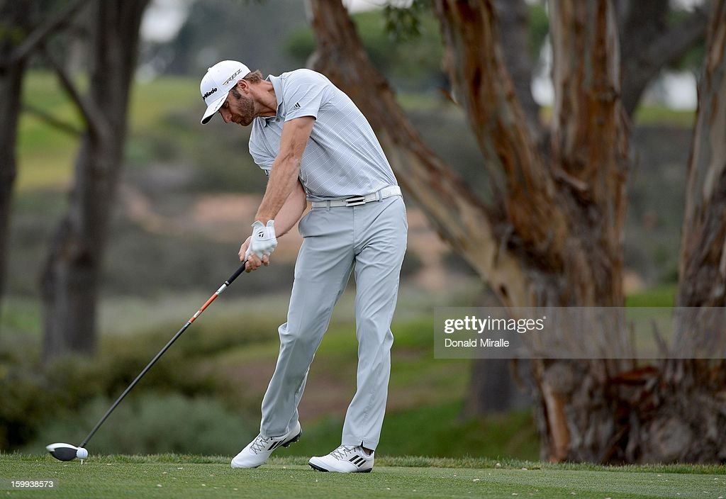 <a gi-track='captionPersonalityLinkClicked' href=/galleries/search?phrase=Dustin+Johnson&family=editorial&specificpeople=3908453 ng-click='$event.stopPropagation()'>Dustin Johnson</a> tees off the 5th hole during the Pro-Am at the Farmers Insurance Open at Torrey Pines Golf Course on January 23, 2013 in La Jolla, California.