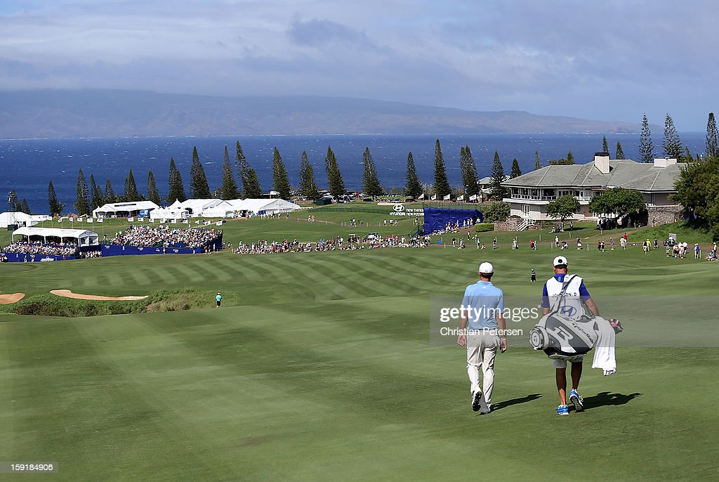Dustin Johnson walks down the 18th hole fairway during the final round of the Hyundai Tournament of Champions at the Plantation Course on January 8, 2013 in Kapalua, Hawaii.