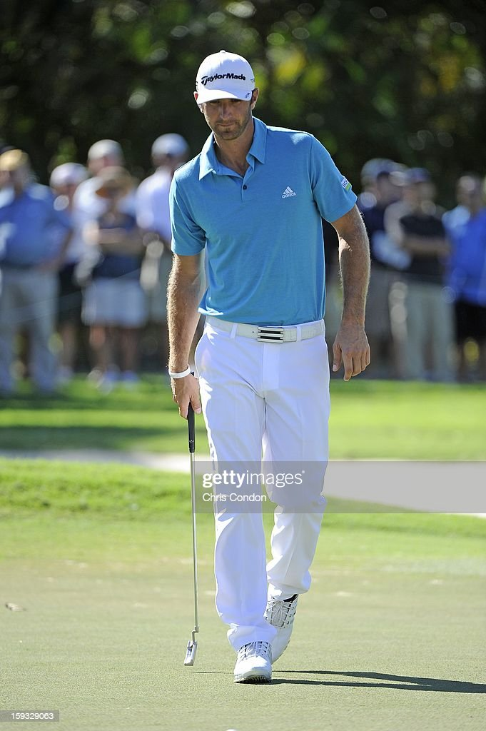 Dustin Johnson walks off the ninth green after withdrawing from the tournament citing flu-like symptoms during the second round of the Sony Open in Hawaii at Waialae Country Club on January 11, 2013 in Honolulu, Hawaii.