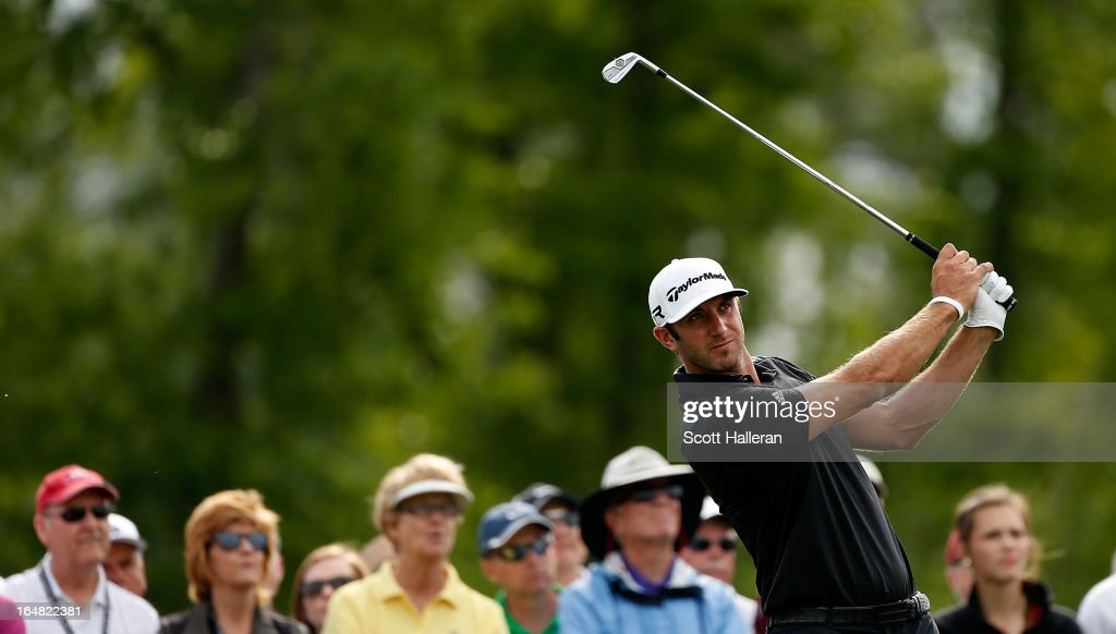 Dustin Johnson watches his tee shot on the 16th hole during the first round of the Shell Houston Open at the Redstone Golf Club on March 28, 2013 in Humble, Texas.