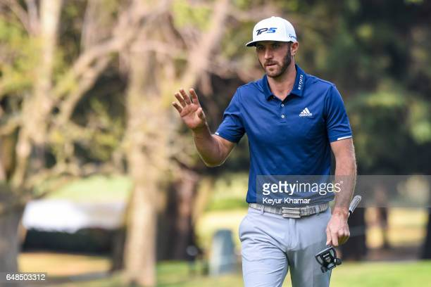 Dustin Johnson waves to fans after putting on the 16th hole green during the final round of the World Golf ChampionshipsMexico Championship at Club...