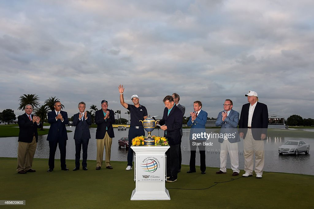 Dustin Johnson waves to fans during the Gene Sarazen Cup trophy presentation ceremony following his one stroke victory in the final round of the World Golf Championships-Cadillac Championship at Blue Monster, Trump National Doral, on March 8, 2015 in Doral, Florida.