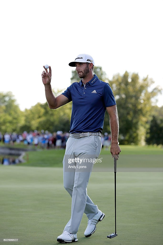 Dustin Johnson waves to the crowd after winning the BMW Championship at Crooked Stick Golf Club on September 11, 2016 in Carmel, Indiana.