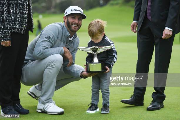 Dustin Johnson's son Tatum Gretzky Johnson helps hold up the trophy after winning the Genesis Open golf tournament at the Riviera Country Club on...