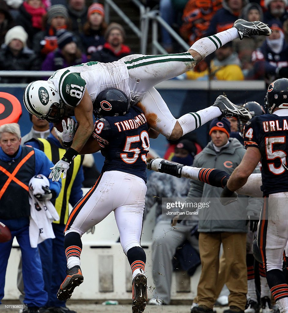 <a gi-track='captionPersonalityLinkClicked' href=/galleries/search?phrase=Dustin+Keller&family=editorial&specificpeople=2160327 ng-click='$event.stopPropagation()'>Dustin Keller</a> #81 of the New York Jets goes airbourne over <a gi-track='captionPersonalityLinkClicked' href=/galleries/search?phrase=Pisa+Tinoisamoa&family=editorial&specificpeople=758205 ng-click='$event.stopPropagation()'>Pisa Tinoisamoa</a> #59 of the Chicago Bears for a first down at Soldier Field on December 26, 2010 in Chicago, Illinois. The Bears defeated the Jets 38-34.