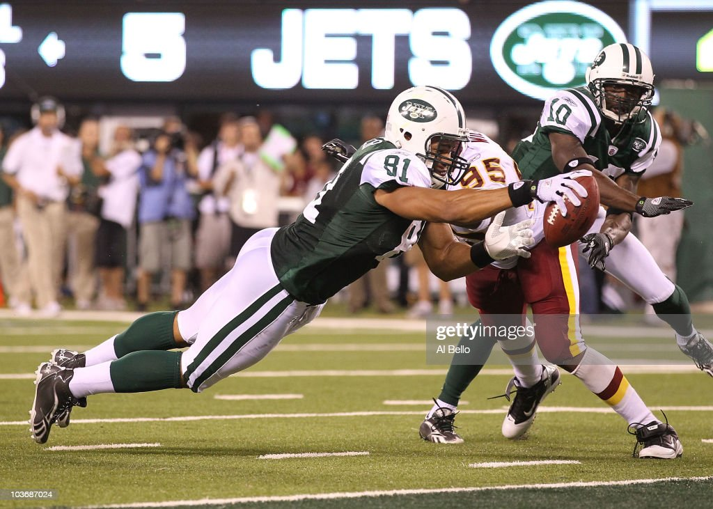 <a gi-track='captionPersonalityLinkClicked' href=/galleries/search?phrase=Dustin+Keller&family=editorial&specificpeople=2160327 ng-click='$event.stopPropagation()'>Dustin Keller</a> #81 of the New York Jets scores a touchdown as Chris Wilson #95 of the Washington Redskins misses the tackle in the fourth quarter during their preseason game on August 27, 2010 at the New Meadowlands Stadium in East Rutherford, New Jersey.