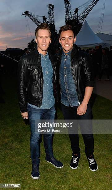 Dustin Lance Black and Tom Daley arrive at the Battersea Power Station Annual Party on April 30 2014 in London England