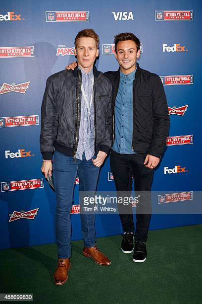 Dustin Lance Black and Tom Daley attend as the Dallas Cowboys play the Jacksonville Jaguars in an NFL match at Wembley Stadium on November 9 2014 in...